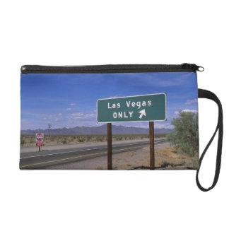 Roadside sign showing direction, California Wristlets