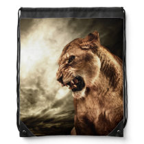 Roaring lioness against stormy sky drawstring backpack