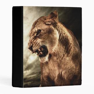 Roaring lioness against stormy sky mini binder
