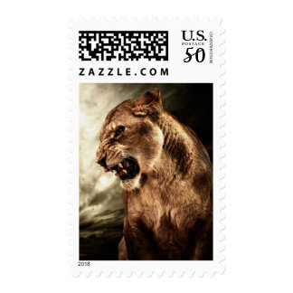 Roaring lioness against stormy sky postage