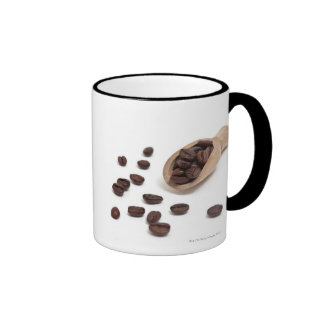 roast coffee beans with scoop coffee mugs