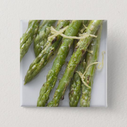 Roasted green asparagus with lemon zest, button
