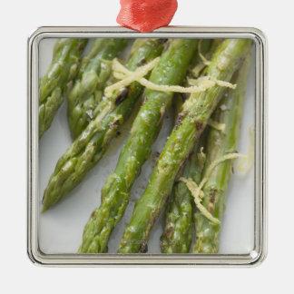 Roasted green asparagus with lemon zest, metal ornament