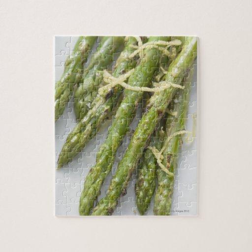 Roasted green asparagus with lemon zest, jigsaw puzzles