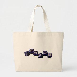 Robert toy blocks in blue tote bag