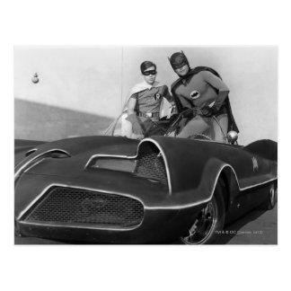 Robin and Batman Standing in Batmobile Postcard