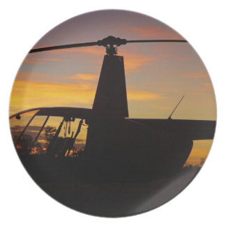 Robinson R44 helicopter at sunset Dinner Plate
