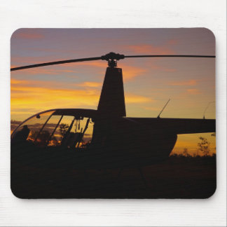Robinson R44 helicopter at sunset Mouse Pad
