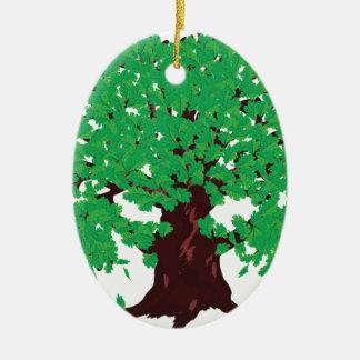 Roble con las hojas verdes adorno navideño ovalado de cerámica