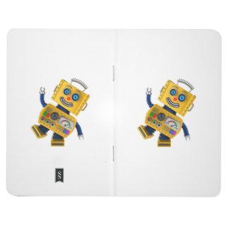 Robot amarillo torpe del juguete cuaderno grapado