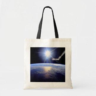 Robot Arm Over Earth with Sunburst Canvas Bag