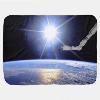 Robot Arm Over Earth with Sunburst Stroller Blanket