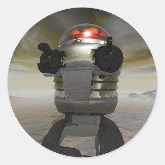 Robot del juguete en un pegatina extranjero del