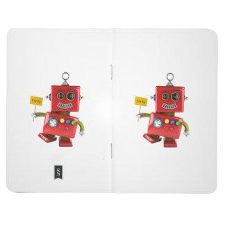 Robot rojo de baile del juguete con la muestra del cuaderno grapado