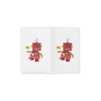 Robot rojo de baile del juguete con la muestra del funda para libreta y libreta pequeña moleskine