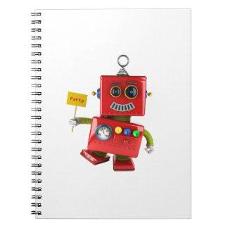 Robot rojo de baile del juguete con la muestra del libreta