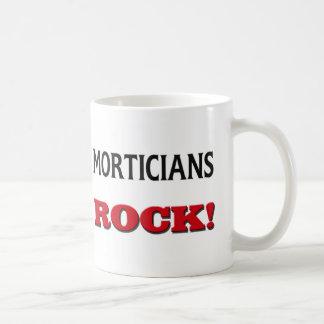 Roca de los empresarios de pompas fúnebres taza de café