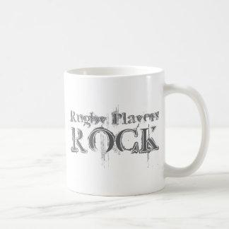 Roca de los jugadores del rugbi tazas de café