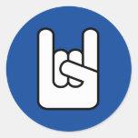 roca en el pegatina azul del icono de la mano de