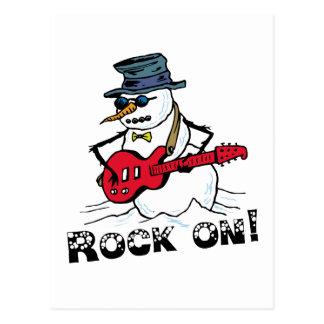 Roca en la guitarra que juega el muñeco de nieve postal