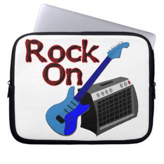 Roca en la guitarra y el amperio mangas computadora