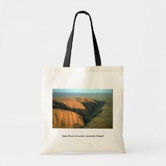 Roca en la puesta del sol desierto de Ayers de Au Bolsa Lienzo