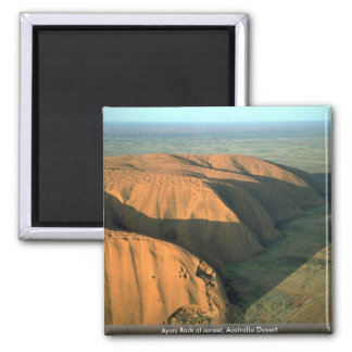 Roca en la puesta del sol desierto de Ayers de Au Imanes