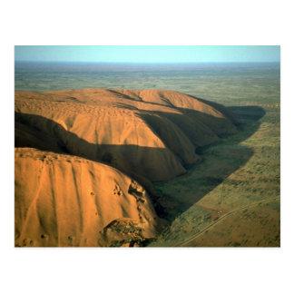 Roca en la puesta del sol desierto de Ayers de Au Tarjetas Postales