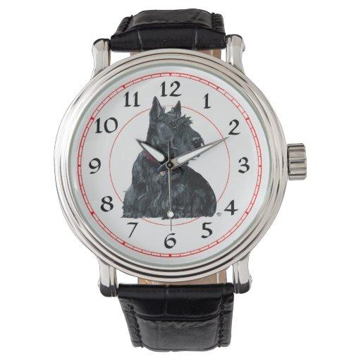 Rocas del perro del escocés alrededor reloj de mano