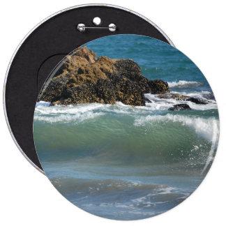 Rocas y ondas, botón colosal