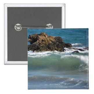 Rocas y ondas, botón cuadrado