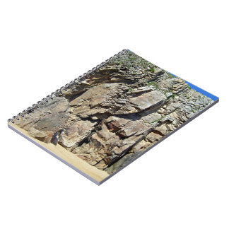 Rock formation against a clear blue sky notebook
