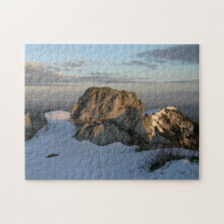 Rock on snowy mountain puzzles