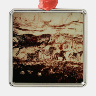 Rock painting of a leaping cow metal ornament