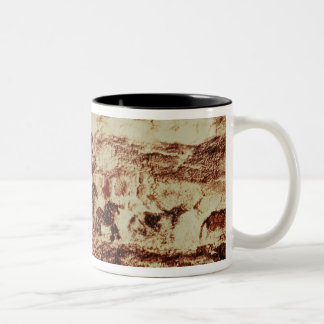 Rock painting of a leaping cow Two-Tone coffee mug