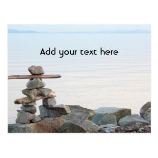 Rock stacking art by the beach. photo by Hao zhang Postcard