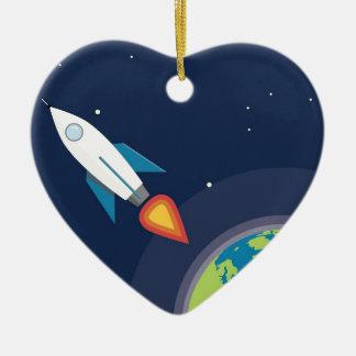 Rocket en diseño gráfico de la tierra de la luna adorno navideño de cerámica en forma de corazón