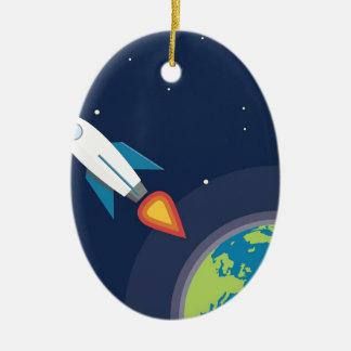 Rocket en diseño gráfico de la tierra de la luna adorno navideño ovalado de cerámica