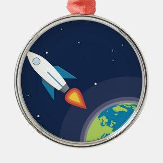 Rocket en diseño gráfico de la tierra de la luna adorno navideño redondo de metal