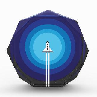 Rocket ship flies past the Blue Planet Award
