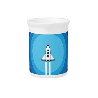 Rocket ship flies past the Blue Planet Beverage Pitcher