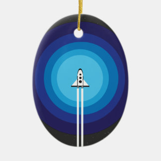 Rocket ship flies past the Blue Planet Ceramic Ornament