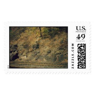 Rocking hills and a railroad tracks postage