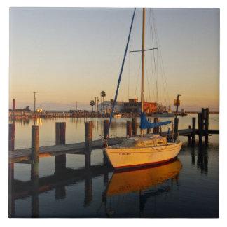 Rockport, Texas harbor at sunset Large Square Tile