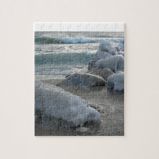 Rocks covered in ice on the sea shore jigsaw puzzle