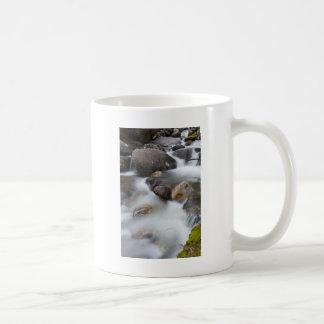 Rocks in a river coffee mugs