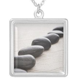 Rocks on sand square pendant necklace