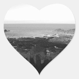 Rocky Beach. Scenic Coastal View. Black and White. Heart Sticker