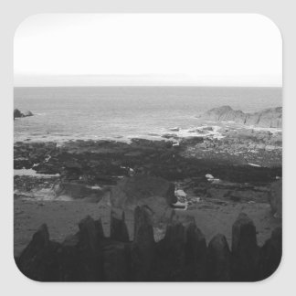 Rocky Beach. Scenic Coastal View. Black and White. Square Sticker