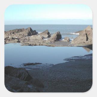 Rocky Beach. Scenic Coastal View. Square Sticker